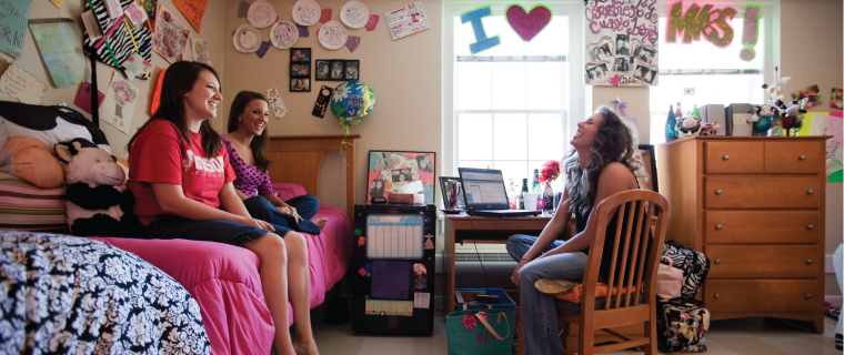 Three Judson students in their dormroom