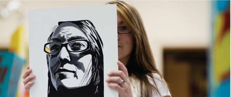 Student with a portrait in black and white
